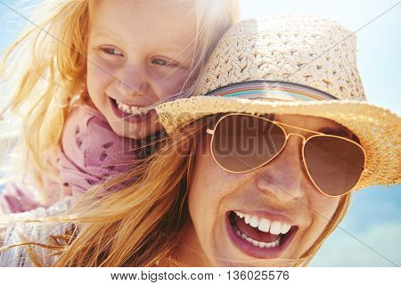 Laughing Young Mother And Daughter Outdoors