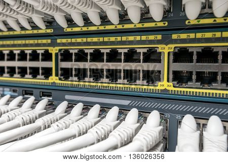 Network Gigabit Smart Switch with network cables installed in the rack
