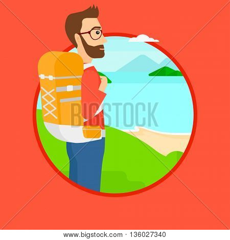 Hipster man with backpack standing on the top of mountain and enjoying the view while looking at landscape of mountains with lake. Vector flat design illustration in the circle isolated on background.