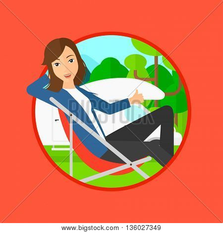 Young woman sitting in a folding chair and giving thumb up on the background of camper van. Woman enjoying vacation in camper van. Vector flat design illustration in the circle isolated on background.
