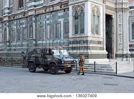 FLORENCE, Italy - January 19, 2016: cathedral Santa Maria del Fiore (Duomo) and soldier of special unit of the italian army  for the operation safe roads as prevention against terrorist attacks. on January 19, 2016 Florence, Tuscany, Italy