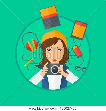 Woman taking photo with digital camera. Young woman surrounded with her electronic gadgets. Woman using many electronic gadgets. Vector flat design illustration in the circle isolated on background.