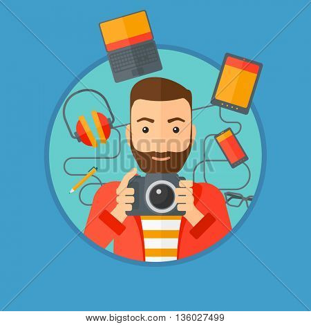 Hipster man with the beard taking photo with digital camera. Young man surrounded with gadgets. Man using many electronic gadgets. Vector flat design illustration in the circle isolated on background.