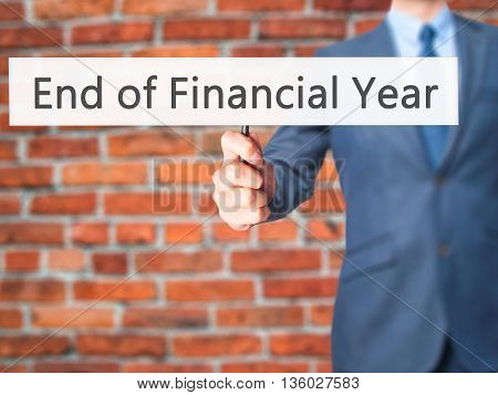 End Of Financial Year - Businessman Hand Holding Sign