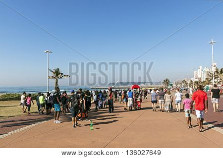 People Walking  On  Promenade On Beach Front