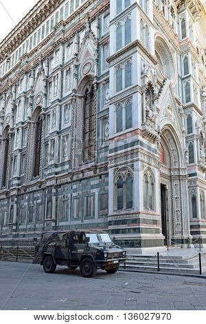 FLORENCE, Italy - January 19, 2016: cathedral Santa Maria del Fiore (Duomo) and jeep of special unit of the italian army  for the operation safe roads as prevention against terrorist attacks. on January 19, 2016 Florence, Tuscany, Italy