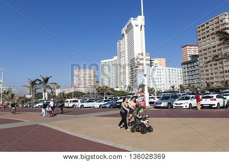 People On Promenade Against City Skyline 1
