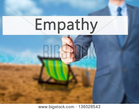 Empathy - Businessman Hand Holding Sign