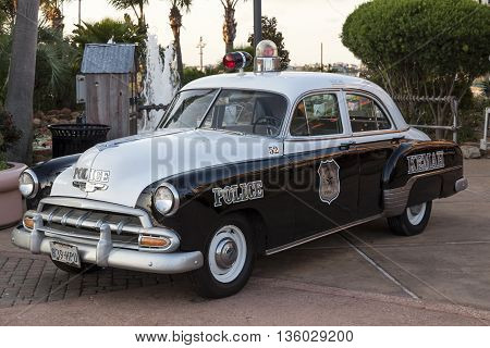 KEMAH TX USA - APR 14 2016: 1952 Chevrolet Styleline Deluxe historic police car of the Kemah Boardwalk police department.