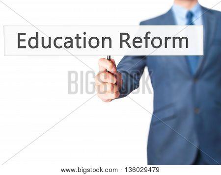 Education Reform - Businessman Hand Holding Sign