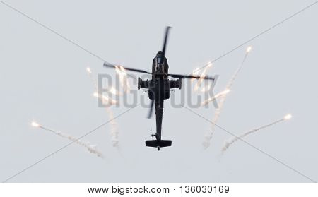 Leeuwarden, The Netherlands - Jun 10, 2016: Dutch Ah-64 Apache Attack Helicopter Firing Off Flares D