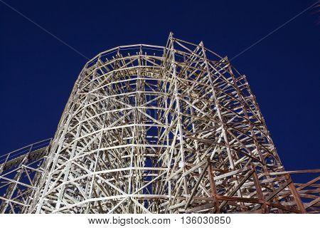 Wooden roller coaster illuminated at night. Kemah Boardwalk Texas United States