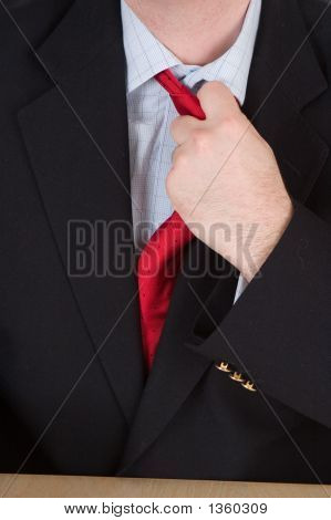 Business Man Loosening His Red Tie
