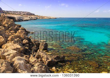seashore - azure transparent sea and rocks in water coast of Mediterranean Sea at sunny summer day. Coast of Cyprus Ayia Napa.