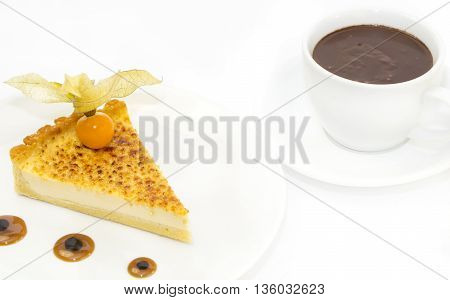 piece of cake with passion fruit and a cup of hot chocolate