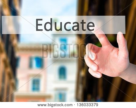 Educate - Hand Pressing A Button On Blurred Background Concept On Visual Screen.