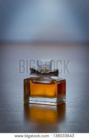 square women's perfume bottle on a dark background