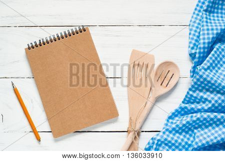 Cooking utensils on white wooden table. Top view with copy space