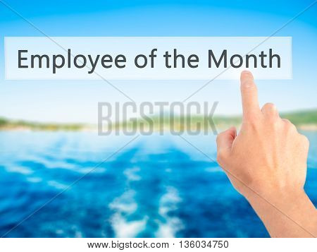 Employee Of The Month - Hand Pressing A Button On Blurred Background Concept On Visual Screen.