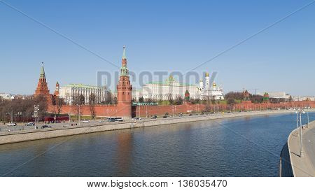 Moscow - April 12 2015: View of the Kremlin and the Kremlin embankment across the Moscow River and the Kremlin green lawn in early spring April 12 2015 Moscow Russia