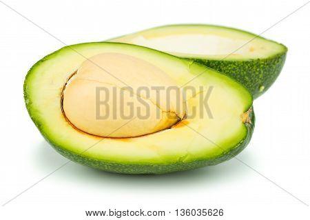 Two halves of avocado on white background