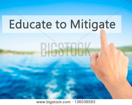Educate To Mitigate - Hand Pressing A Button On Blurred Background Concept On Visual Screen.