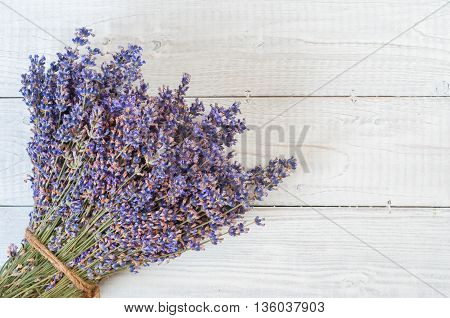 fresh lavender flowers on white wood table background free space