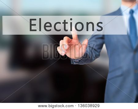 Elections - Businessman Hand Pressing Button On Touch Screen Interface.