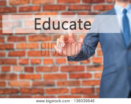 Educate - Businessman Hand Pressing Button On Touch Screen Interface.