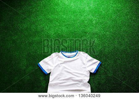 Sports T-shirt Against Artificial Turf. Studio Shot. Copy Space.