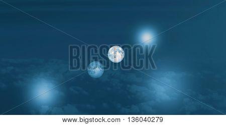 Fantastic landscape pf two full moon in dark sky