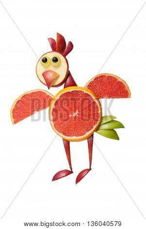 Funny flying chicken made of grapefruit on white background
