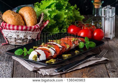 Caprese Salad On Black Plate