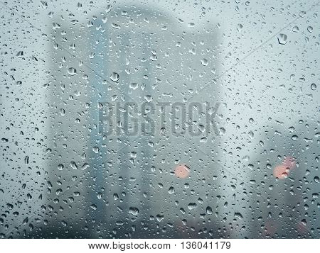 Selective focus, Raindrops on glass with city (raindrops,blur,city)