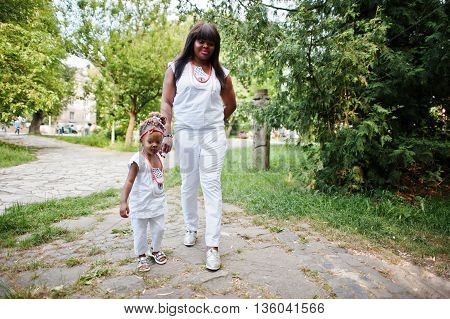 African American Mother With Daughter Walking At Park