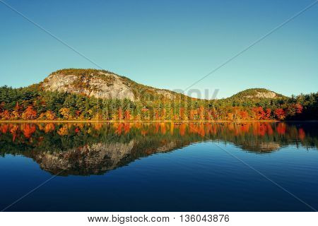 Autumn foliage with lake in New England area.