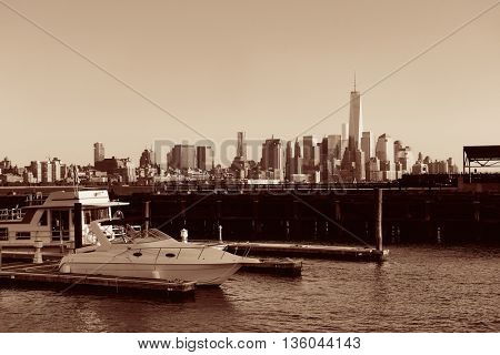Manhattan downtown skyline with urban skyscrapers and boat