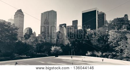 Central Park Autumn ice rink midtown skyline in Manhattan New York City