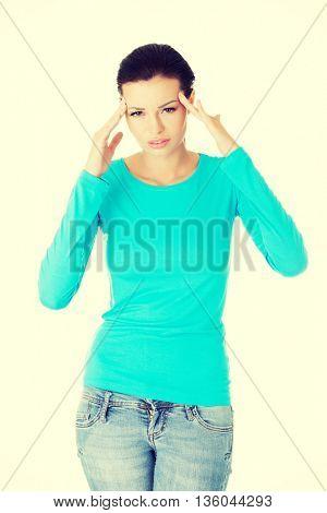 Woman with a headache holding head