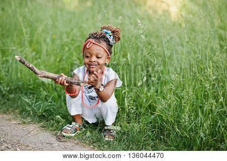 African baby girl walking at park outdoor
