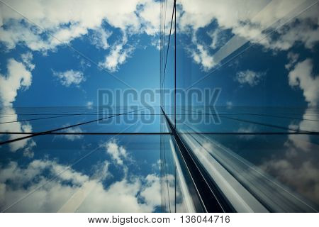 Glass reflection of skyscraper in Paris.