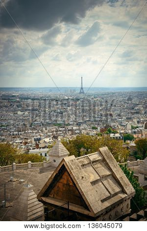 View from top of Sacre Coeur Cathedral with Eiffel Tower in Paris, France.
