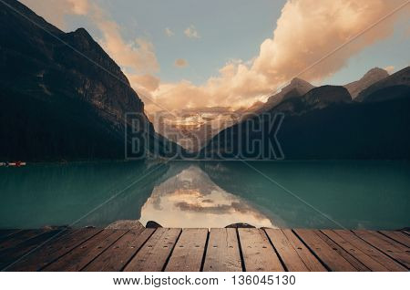 Lake Louise after rain at sunset with cloud and reflection