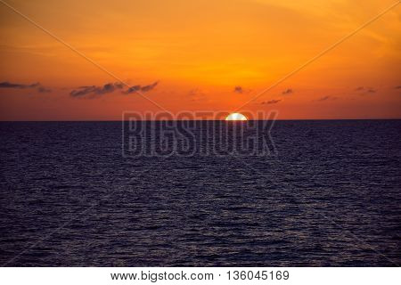 A view of the sun setting as seen from a cruise ship in the North Atlantic.