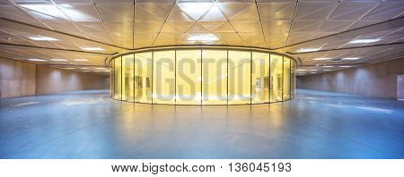 round glass display window in hall of modern shopping mall