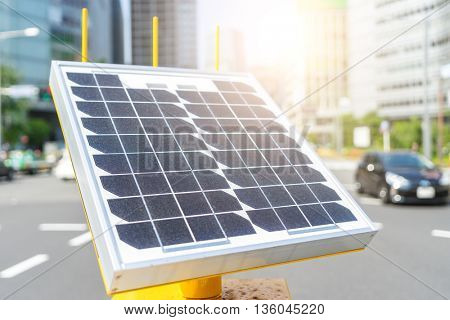 solar panel on street in tokyo with sunbeam