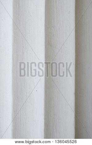 Closeup face of white stone columns vertically
