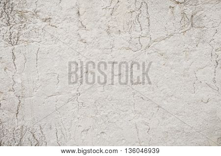 Texture of old concrete wall with cracks, light