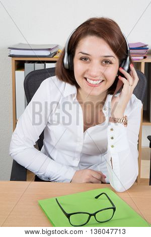 Successful Female Call Center Employee Wearing A Headset