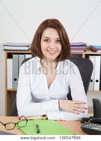 Cheerful Female Call Centre Employee Wearing White Shirt And Glasses